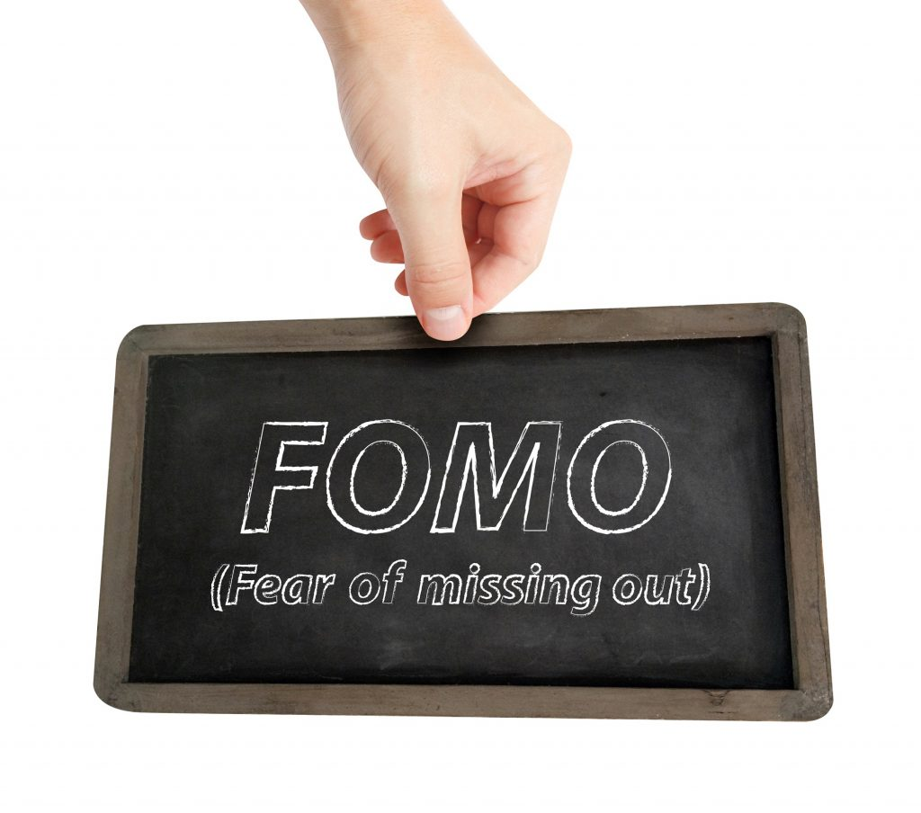 FOMO written on chalkboard