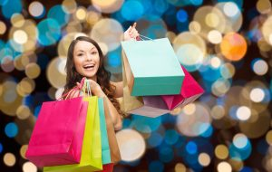 happy woman with colorful shopping bags